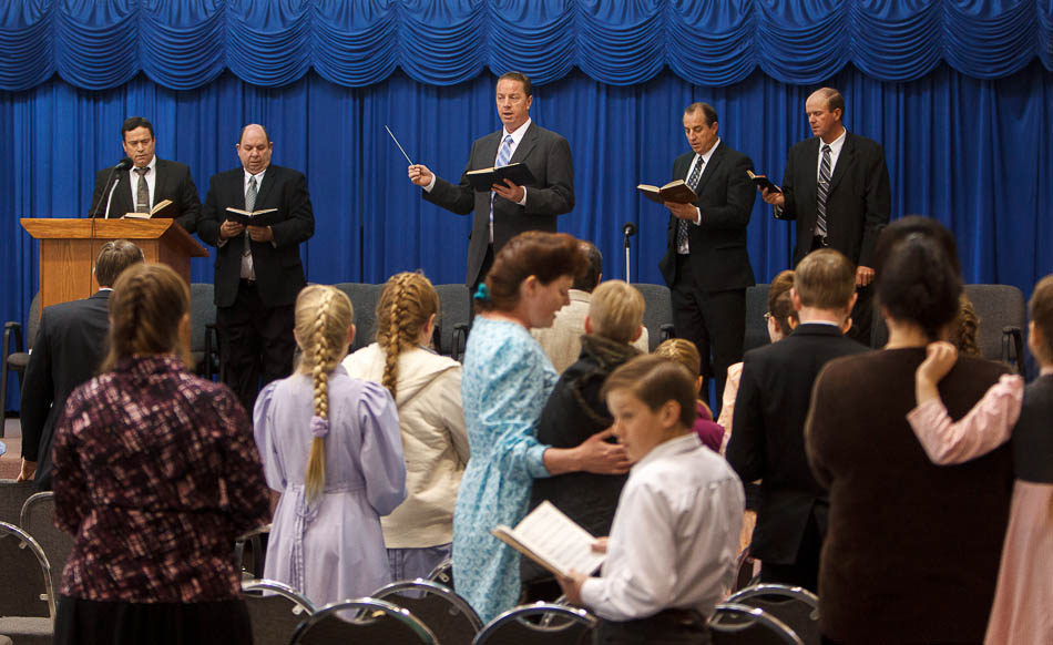 Sam Allred leads the congragation in a hymn during a church service of ex-FLDS members Sunday, February 17, 2013 in Hildale. Left to right on stage are William E. Jessop, Garth Warner, Allred, Dan Timpson and Royce Jessop