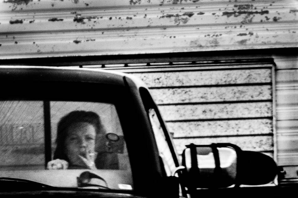 woman driving a truck and smoking