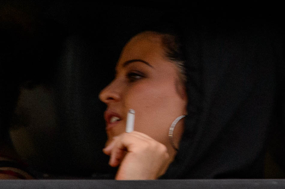 woman smoking and driving
