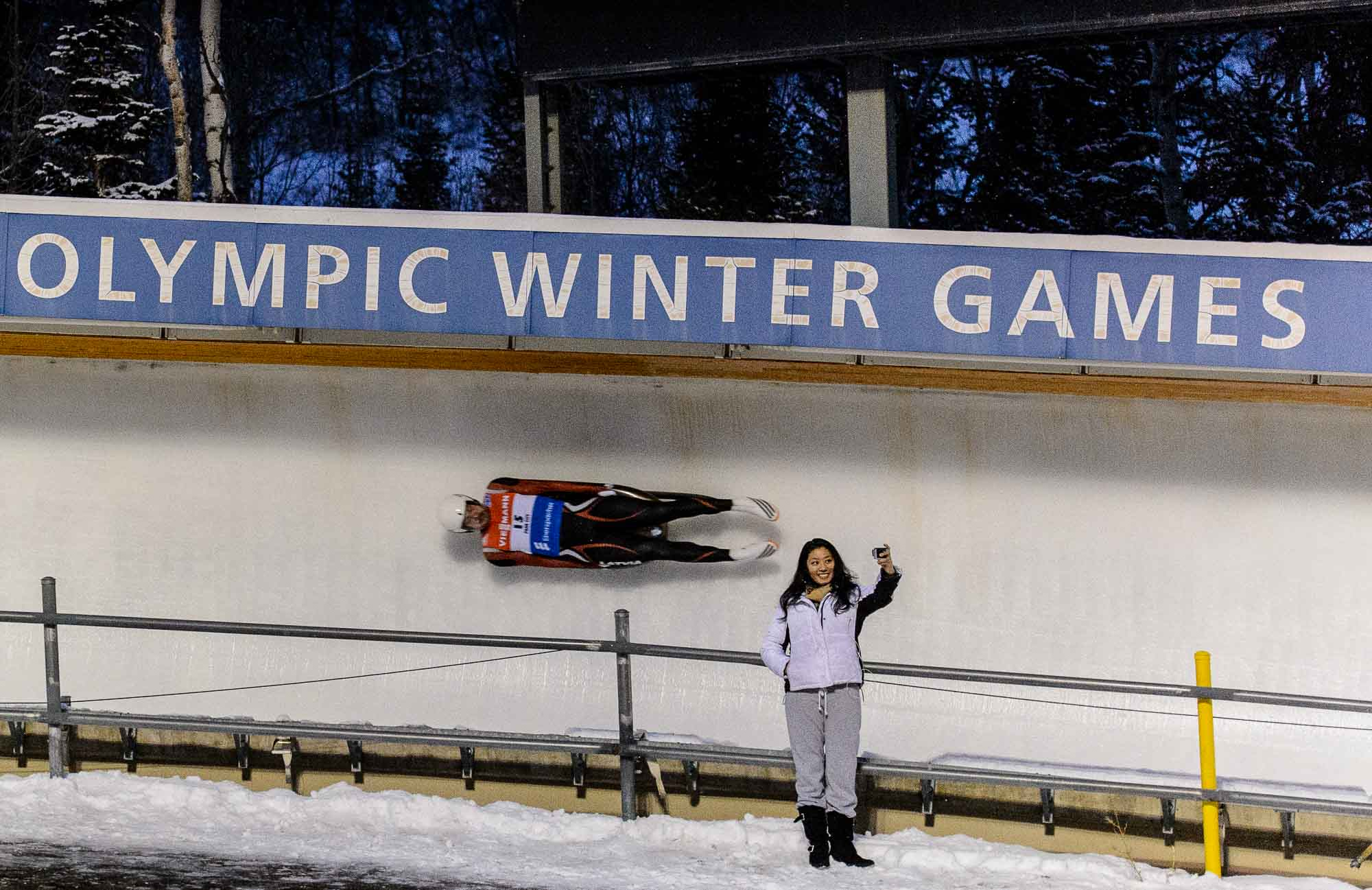 fan takes a selfie at World Cup Luge, Utah Olympic Park