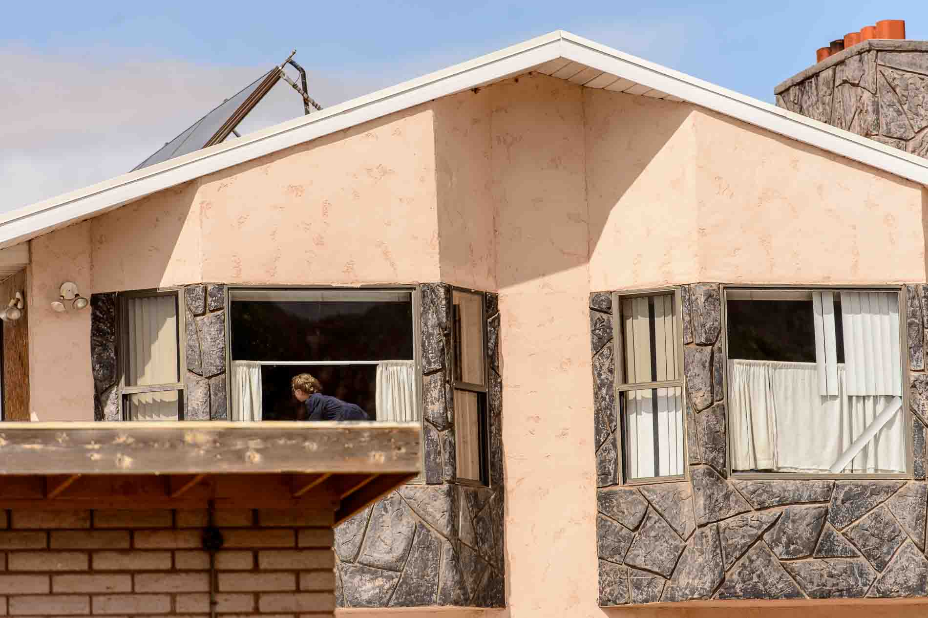 Photo: A girl in the window of a home in Colorado City, Arizona