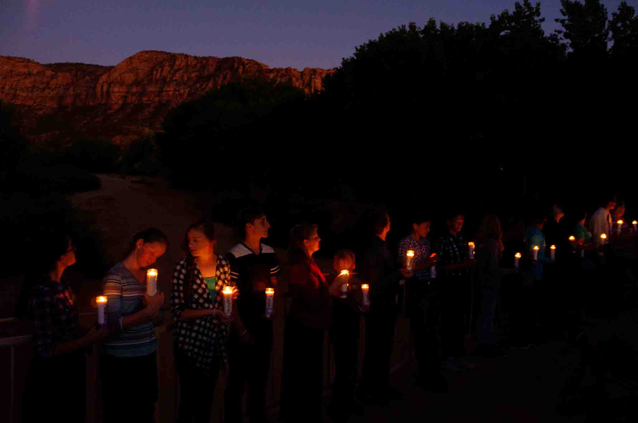 Photo: Residents of Hildale, UT and Colorado City, AZ, hold candles on a bridge over Short Creek during a memorial to the victims of the 2015 flash flood