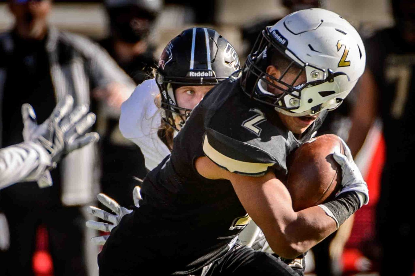 Desert Hills' Nephi Sewell runs after a face mask penalty spun his helmet as Desert Hills faces Pine View in the Class 3AA high school football state championship at Rice-Eccles Stadium in Salt Lake City